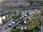 View larger image of Aerial view of motorhomes and mountainside at PAGOSA RIVERSIDE CAMPGROUND image #8