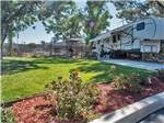 View larger image of An RV with its slideout out at VACATIONER RV PARK - SUNLAND image #8