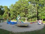 View larger image of Playground with swing set at OAK HAVEN FAMILY CAMPGROUND image #5