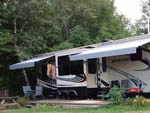 View larger image of Big trailer with awnings at OAK HAVEN FAMILY CAMPGROUND image #7
