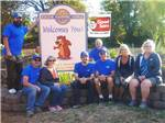 View larger image of Campground workers sitting in front of sign at entrance to RV park at EUGENE KAMPING WORLD RV PARK image #3