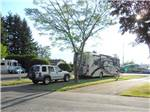 View larger image of RV and white SUV parked at EUGENE KAMPING WORLD RV PARK image #8