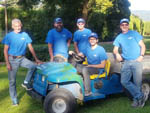 View larger image of Five men in blue shirts staff at EUGENE KAMPING WORLD RV PARK image #12