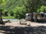 View larger image of An RV site by the river at GLENWOOD CANYON RESORT image #3