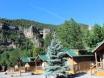 View larger image of A row of camping cabins at GLENWOOD CANYON RESORT image #7