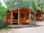 View larger image of A close up of two of the wooden cabins at GLENWOOD CANYON RESORT image #8