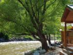 View larger image of One of the cabins by the river at GLENWOOD CANYON RESORT image #10