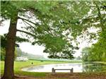 View larger image of Lake with motorhome and green trees at SPRING GULCH RESORT CAMPGROUND image #1