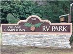 View larger image of Sign at entrance to RV park at VILLAGE CAMPER INN RV PARK image #1