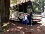 View larger image of People camping in RV at VILLAGE CAMPER INN RV PARK image #9