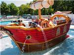 View larger image of Kids playing in the pirate ship at the waterpark at OCEAN VIEW RESORT CAMPGROUND image #1