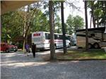 View larger image of Tour bus at the park at AMERICAMPS RV RESORT image #9