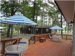 View larger image of Cabin with deck at AMERICAMPS RV RESORT image #10