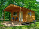 View larger image of View of cabin with porch and barbeque at FOX HILL RV PARK  CAMPGROUND image #4