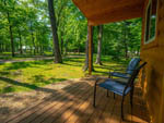 View larger image of View from cabin porch with 2 chairs at FOX HILL RV PARK  CAMPGROUND image #5
