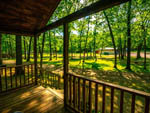 View larger image of View from cabin of sunlit grass and trees at FOX HILL RV PARK  CAMPGROUND image #6