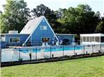 View larger image of Swimming pool at campground at FAYETTEVILLE RV RESORT  COTTAGES image #6