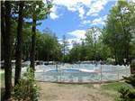 View larger image of Kidney-shaped gated swimming pool at WILD ACRES RV RESORT  CAMPGROUND image #3