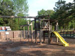 View larger image of Playground with swing set and slide at ZOOLAND FAMILY CAMPGROUND image #9