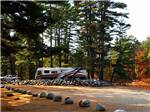 View larger image of An empty gravel RV site at LAKE GEORGE RIVERVIEW CAMPGROUND image #6