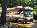 View larger image of A motorhome with kayaks sitting in front at LAKE GEORGE RIVERVIEW CAMPGROUND image #10