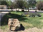 View larger image of View of park with flower bed at PHILLIPS RV PARK image #4