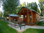 View larger image of Log cabins with decks at YELLOWSTONE RIVER RV PARK  CAMPGROUND image #6