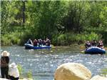 View larger image of People on 2 rafts rafting at RIVERNOOK CAMPGROUND image #4