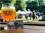 View larger image of Glass of beer and campers at RIVERNOOK CAMPGROUND image #7