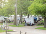 View larger image of Trailers camping with speed limit sign and wooden fence at DOUBLE J CAMPGROUND image #2