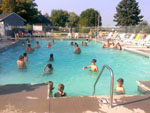 View larger image of People swimming in the pool at DOUBLE J CAMPGROUND image #5