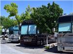 View larger image of A row of three Class RVs at HITCHIN POST RV PARK image #6