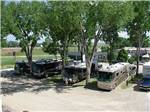 View larger image of RVs parked in gravel sites under trees at INDIAN CAMPGROUND  RV PARK image #3