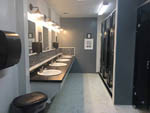 View larger image of Four sinks and three bathroom stalls at MOUNTAIN VIEW RV PARK  CAMPGROUND image #4