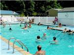 View larger image of A large group of people in the pool at WALNUT HILLS CAMPGROUND AND RV PARK image #3