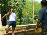 View larger image of Couple playing frisbee golf at WALNUT HILLS CAMPGROUND AND RV PARK image #5