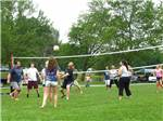 View larger image of A group of people playing volleyball at WALNUT HILLS CAMPGROUND AND RV PARK image #7