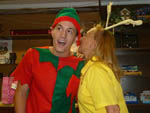 View larger image of 2 people enjoying the Christmas party at WALNUT HILLS CAMPGROUND AND RV PARK image #12