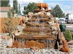 View larger image of Tiered rock water feature with carved stone bears at USA RV PARK image #9