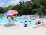 View larger image of People swimming in the pool at MERRY MEADOWS RECREATION FARM image #2
