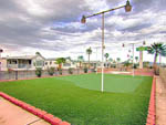 View larger image of Putting green with lights at CARAVAN OASIS RV RESORT image #7