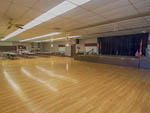 View larger image of Large hall with stage and dance floor at CARAVAN OASIS RV RESORT image #8