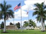 View larger image of Flagpoles at office at INDIAN CREEK RV RESORT image #8