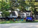 View larger image of An RV site and a car at KING NUMMY TRAIL CAMPGROUND image #2