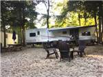 View larger image of An RV site with chairs at KING NUMMY TRAIL CAMPGROUND image #3