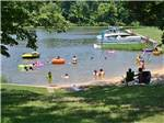 View larger image of Boats docked on water with trees and grass at CHRISTOPHER RUN CAMPGROUND image #1