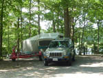 View larger image of Trailer and SUV parked in a site at CHRISTOPHER RUN CAMPGROUND image #4