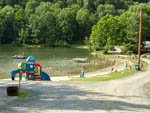 View larger image of Kids swimming in the lake at LIMEHURST LAKE CAMPGROUND image #3