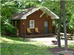 View larger image of Log cabin with deck at TUCQUAN PARK FAMILY CAMPGROUND image #5
