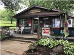 View larger image of The general store with a deck at TUCQUAN PARK FAMILY CAMPGROUND image #9